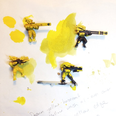 Various experiments using washes over Army Painter Daemonic Yellow Spray. Whatever technique I used had to scale up to vehicles and battlesuits, hence my choice of yellow spray for the base coat.